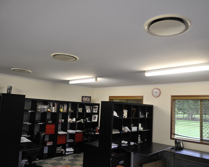 air conditioning ducts on the ceiling of a commercial office space