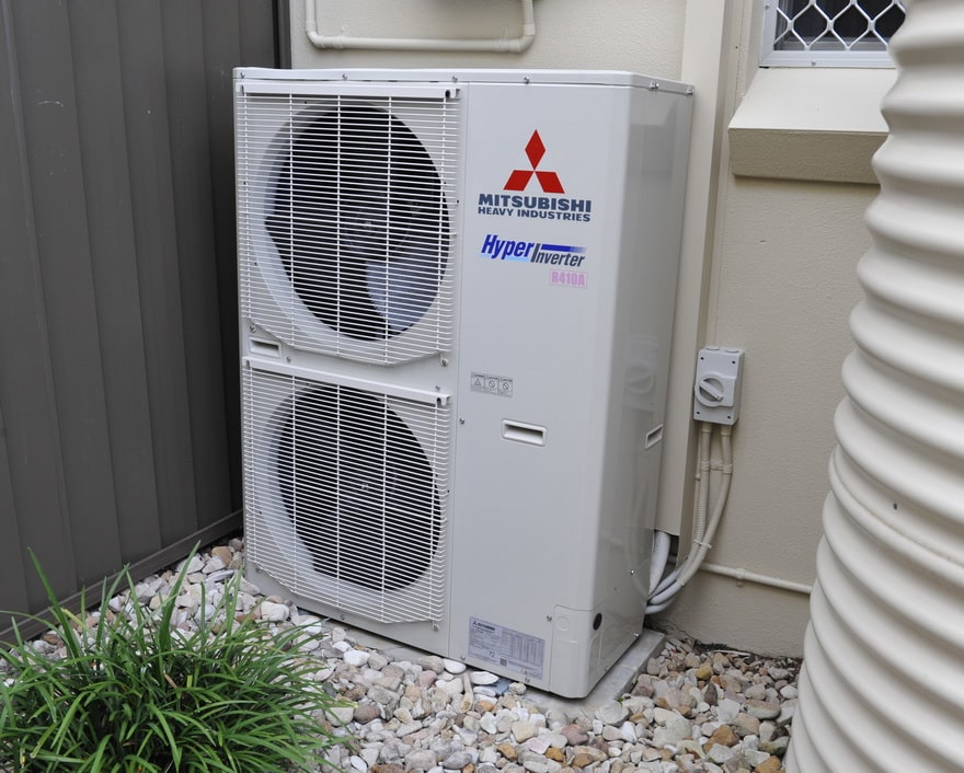 air conditioning unit standing outside a residence