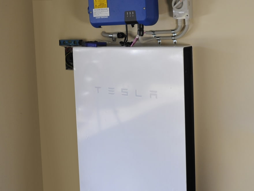 Tesla lithium battery hanging on a wall