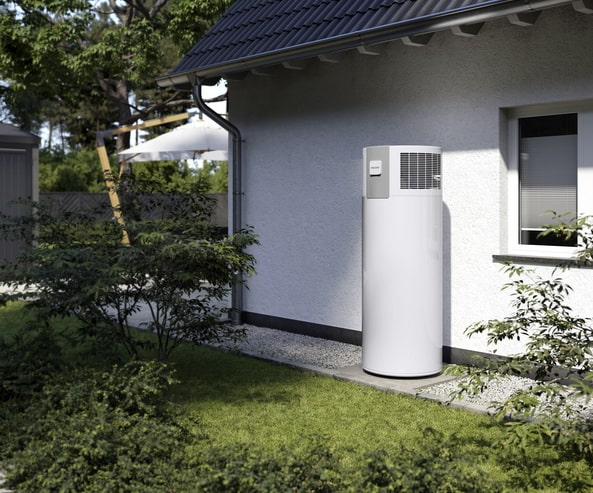 a hot water pump standing by the side of a house