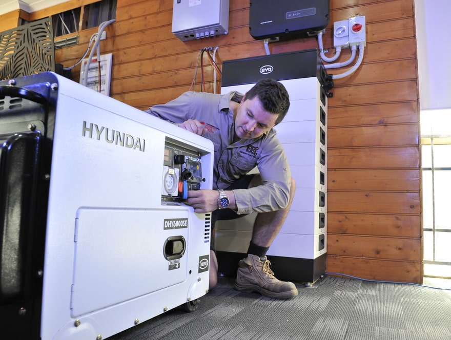 expert electrical employee tinkering with a hyundai generator