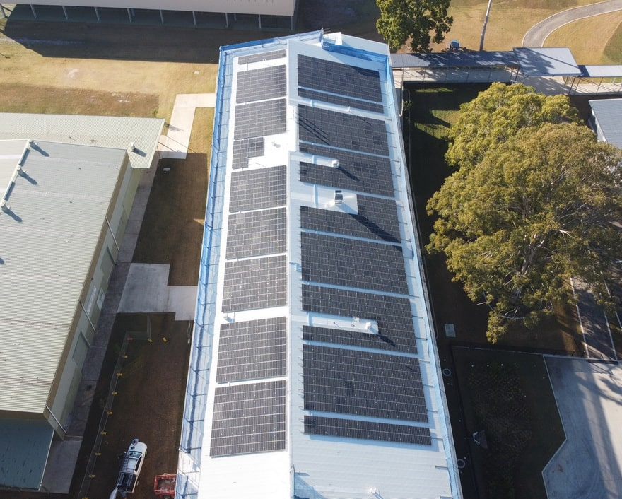Big commercial building roof completely covered in solar panels
